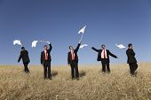 Group of businessman in the field raise the white flag