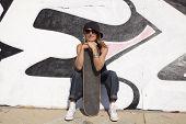 cool skateboard woman at a public graffiti park