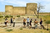 The young people help the archeologist. Fortress Ackerman, city Belgorod-Dnestrovskiy, Ukraine, Euro
