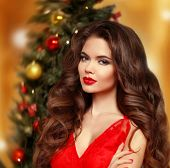Christmas Woman. Beautiful Smiling Girl Model. Makeup. Healthy Long Hair Style. Manicured Nails. Ele poster