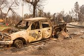 Charred Truck In Front Of Home Burned To The Ground In The Recent Wild Fire Fire Storm In Redding, C poster