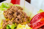 Detail On A Tuna Salad Being Dressed With Spanish Extra Virgin Olive Oil. Tomatoes, Lettuce, Tuna An poster