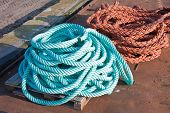 Two Nylon Ropes At A Ship In The Harbor
