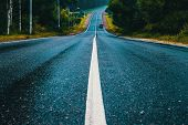 White Dividing Stripe In The Middle Of The Road poster