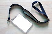 Blank Badge Mockup Isolated On Wooden. Lanyard And Badge. Plastic Badge. Template For Presentation O poster