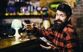 Hipster Holds Wallet, Counting Money To Buy Drinks. Rest And Relax Concept. Guy Spend Leisure In Bar poster
