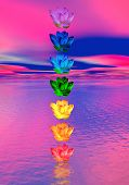 stock photo of chakra  - Chakra colors of lily flower in a column upon ocean in pink and blue background - JPG