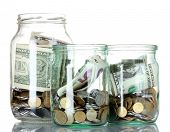 Glass bank for tips with money isolated on white