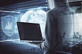 Hacker With Empty Laptop And Glowing Business Hologram On Blurry Office Interior Background. Malware poster