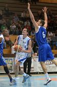 KAPOSVAR, HUNGARY - OCTOBER 15: Jozsef Lekli (in white) in action at a Hugarian National Championship basketball game Kaposvar (white) vs. Jaszbereny (blue) on October 15, 2011 in Kaposvar, Hungary..