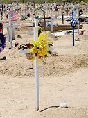 image of osha  - White Cross with Yellow Memorial Ribbon on Grave - JPG