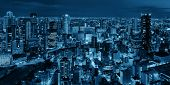 Osaka urban city at night panorama rooftop view. Japan. poster