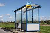 stock photo of bus-shelter  - Urban bus stop shelter by street at summer in Finland - JPG