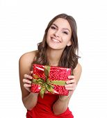 Happy women in red dress with a present