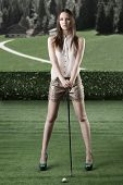 Beautiful Woman Plays Golf, She Is In Front Of The Camera