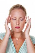 a young woman has a headache and migraine. acupressure therapy.