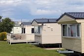 Mobile caravans or trailers in modern holiday park.