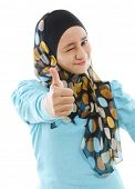 pic of muslimah  - Cute young Muslim girl giving a thumb up sign over white background - JPG