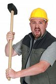 An angry tradesman holding a mallet