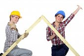 picture of peppy  - Peppy tradeswomen holding up a wooden frame - JPG