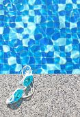 Blue Swimming Goggles On Swimming Pool Background