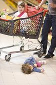 picture of spoiled brat  - young family shopping with trolley at supermarket - JPG