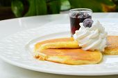 Pancake With Wipcream And Blueberry Syrup