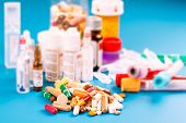 pic of pharmaceuticals  - Medications tablets and capsules in a beaker - JPG