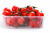 Cherry Tomatoes In A Plastic Basket On A White Background
