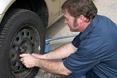 Mechanic Removing Lug Nuts
