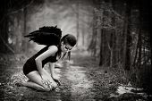 stock photo of gothic hair  - The fantasy image with a fallen angel
