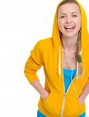 stock photo of hooded sweatshirt  - Happy teenager girl listening music in earphones - JPG