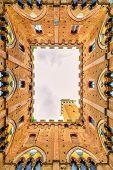 Siena Landmark Photo. Cortile Del Podesta And Mangia Tower. Tuscany, Italy