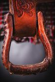 pic of western saddle  - horse saddle leather and various equipment on background - JPG