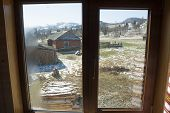 stock photo of zakarpattia  - View through window at landscape of Ukrainian village in Carpathian mountains in early spring - JPG