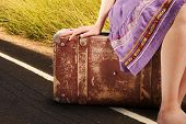 Woman With Old Vintage Suitcase On The Road