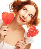 redhair woman with big heart caramel isolated on white