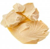 cocoa butter heap close up on white background