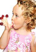 Girl Enjoying  Raspberry