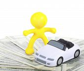 Toy yellow little man car and dollars
