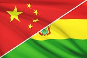 Series Of Ruffled Flags. China And Plurinational State Of Bolivia.