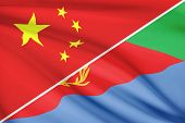Series Of Ruffled Flags. China And State Of Eritrea.