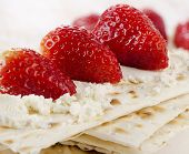 pic of matzah  - matzoh With cheese and berries on a wooden table - JPG
