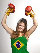 Success Woman Celebrating For Her Succes With The Flag Of Brazil On Her Shirt