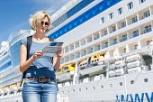 pic of passenger ship  - Woman tourist on shore looking at map - JPG