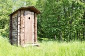 picture of outhouse  - Old wooden outhouse for tourists at a forest - JPG