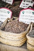 Apothecary, wicker baskets stuffed medicinal healing herbs
