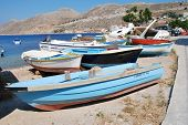 SYMI, GREECE - JUNE 18, 2011: Small boats beached at the Harani boatyard at Yialos on the Greek isla