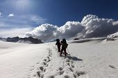 picture of plateau  - Two hikers on snowy plateau - JPG