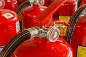 stock photo of fire-station  - Red fire extinguishers available in fire emergencies.
